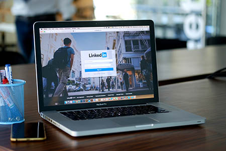Apple Macbook pro with page social network service LinkedIn on the screen
